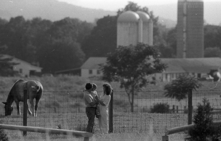 RJ file photo - Bill and Dawn Reed, shown with their 3-year-old daughter, fear development of farmland next to their Grieb Road home could spoil the rural character of their Wallingford neighborhood, July 1989.