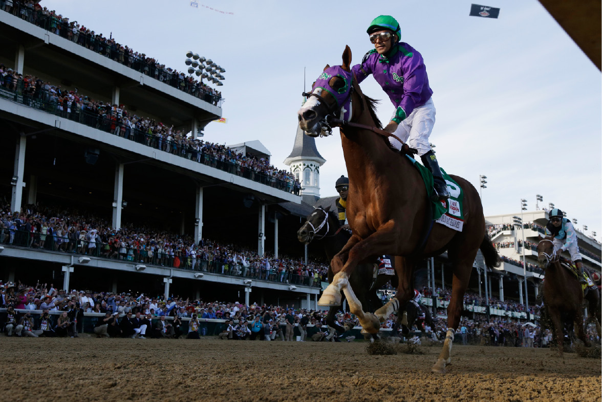 Victor Espinoza rides California Chrome to victory during the 140th running of the Kentucky Derby horse race at Churchill Downs Saturday, May 3, 2014, in Louisville, Ky. (AP Photo/David J. Phillip)