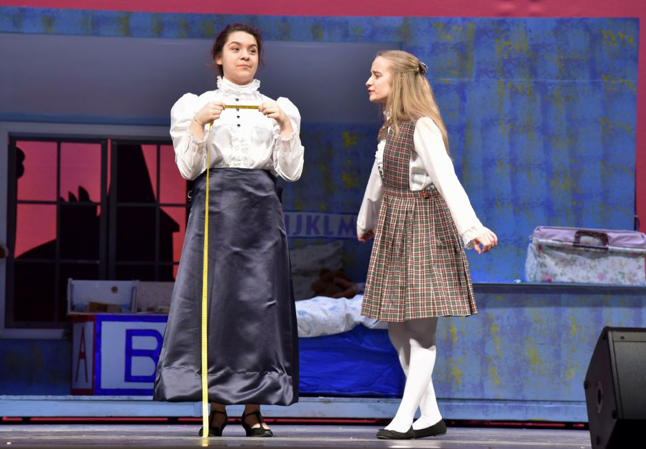 "Maloney High School sophomore Lia Cruz, playing ""Mary Poppins,"" and Sydney Bednarz, playing ""Jane Banks,"" prepare for this weekend"