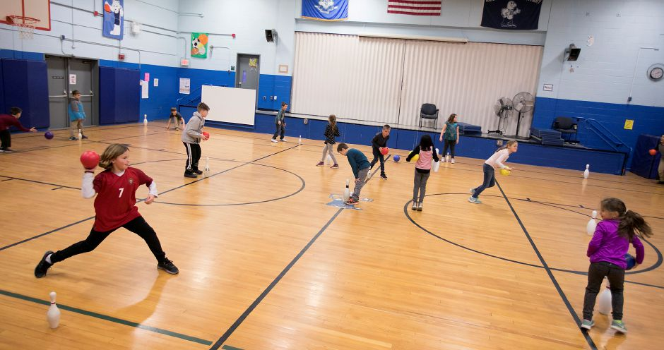 Third-grade students play a game of bowling pin dodge ball during a physical education class at Rock Hill Elementary School in Wallingford, Thursday, Jan. 11, 2018. Rock Hill Elementary School is competing for a $25,000 grant that would go to purchasing indoor and outdoor fitness equipment. Dave Zajac, Record-Journal