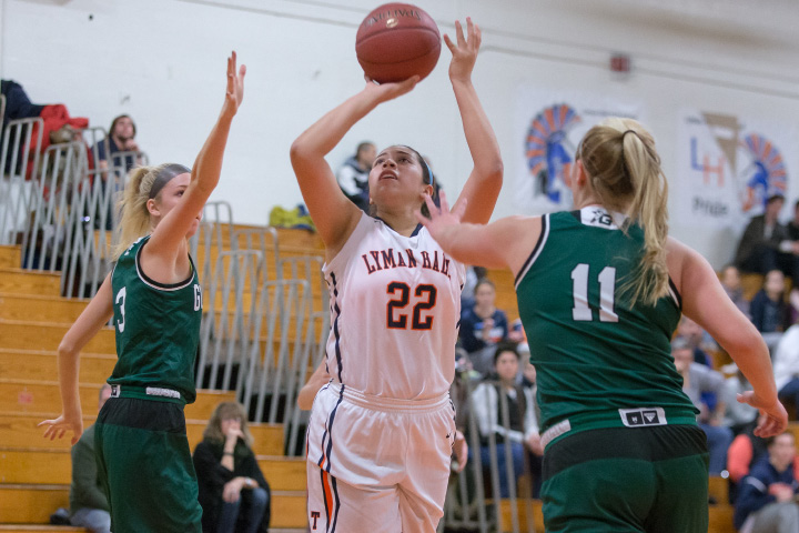 Lyman Hall's Kelly Fernandez finds space in the lane for two points. | Justin Weekes, Special to the Record-Journal