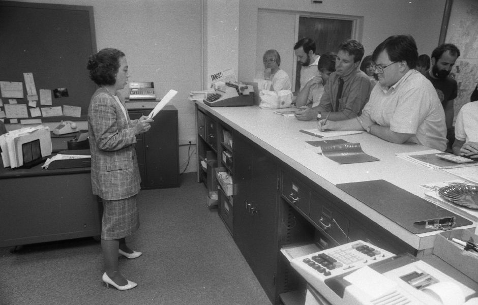 RJ file photo - Wallingford Town Clerk Kathryn Wall announces results of historic district vote Aug. 23, 1989, which fell 19 votes short of passing.