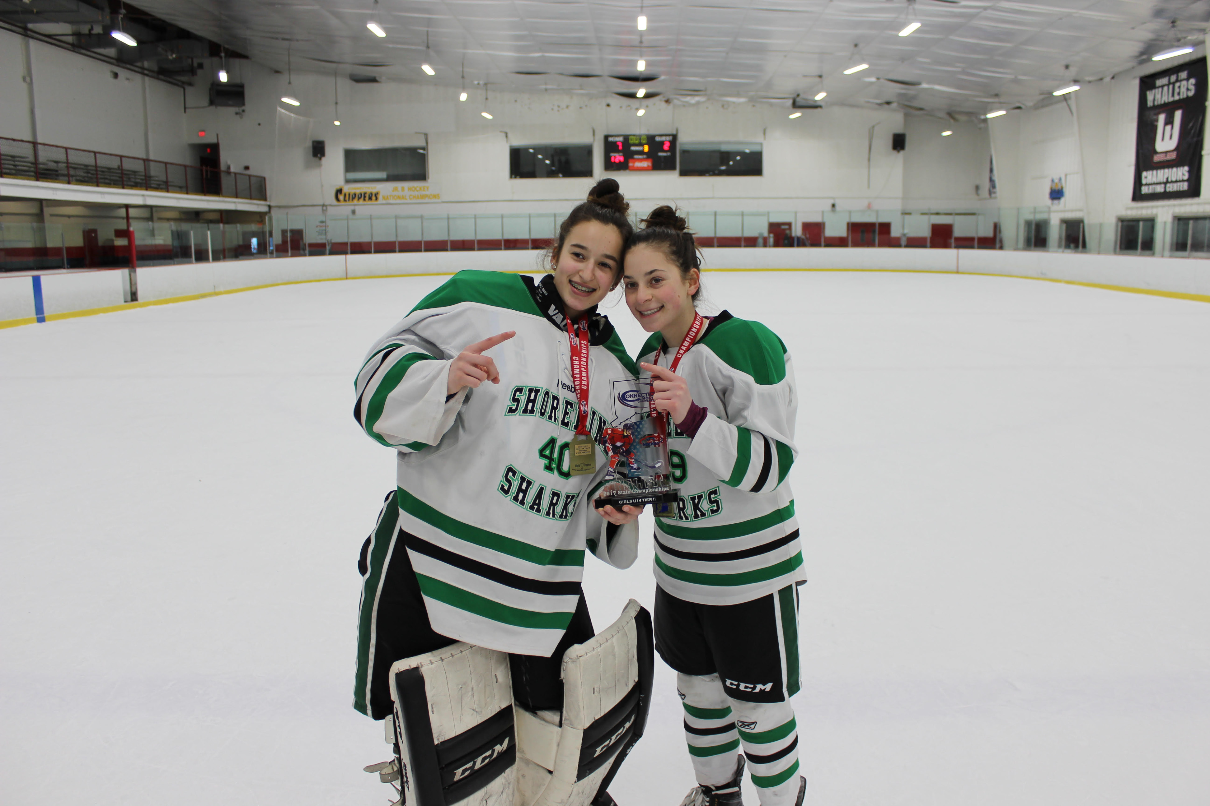 Local hockey players Carina Mancini, left, of Middlefield, and Claire Gavin of Durham pose with the U14 Girls Tier 2 State Championship trophy. Mancini and Gavin play for the Shoreline Sharks organization based in East Haven.  The Sharks defeated the Darien Ice Cats 7-2 Sunday, March 4 at Champions Skating Center in Cromwell. With the win, the Sharks, now representing Connecticut, advance to Regionals in Maine. The winner of the Regionals earns a spot in the USA Hockey Nationals in Michigan.