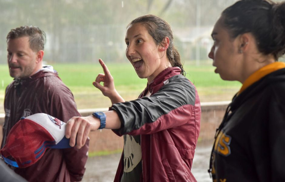 Coach Xannie Brown talks to players after a North Haven Girls Rugby team practice at the athletic complex on April 22, 2019. Their next game is May 2, 4:30 p.m. at the athletic complex. | Bailey Wright, North Haven Citizen