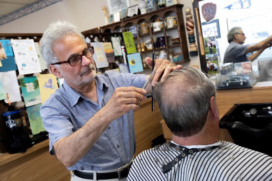 "Barber Prisco ""Pic"" DeLuca gives a haircut to longtime customer Gary Stebbins, of Meriden, at Haircraft Hair Salon, 1259 E. Main St. Meriden, Fri., June 28, 2019. DeLuca is retiring and closing the business after cutting hair for 46 years. Stebbins has been a customer since the early 80"