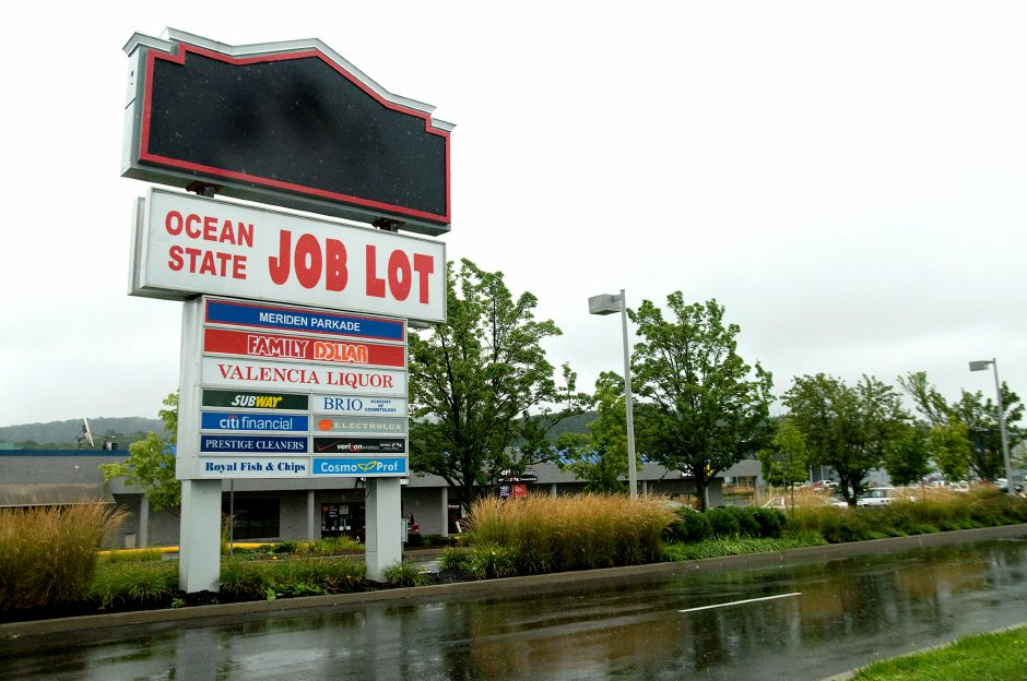 A sign formerly advertising the Lowes in Meriden was taken down less than 24 hours after the store announced its closure, August 15, 2011. (Sarah Nathan/Record-Journal)