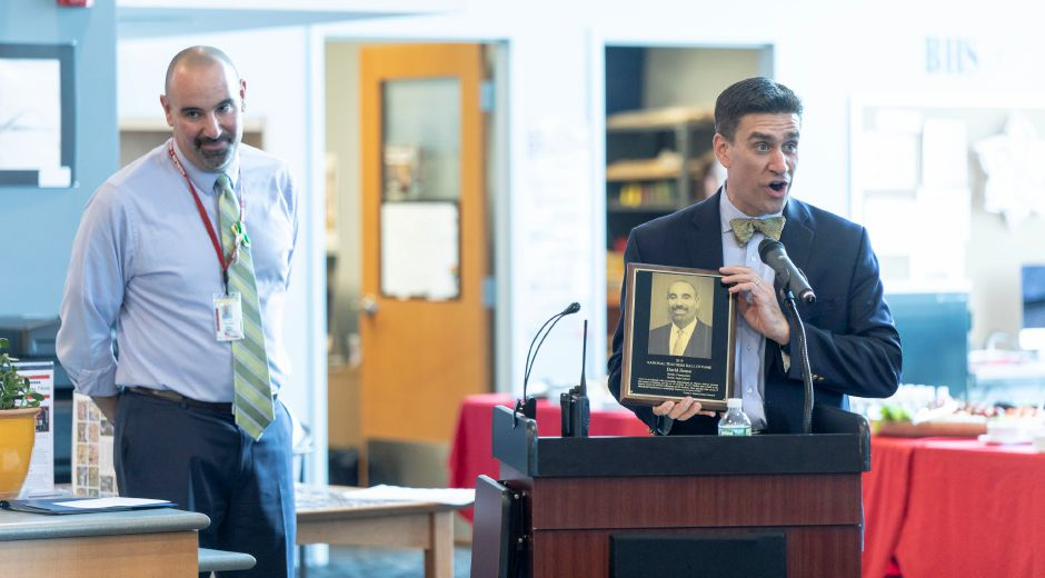 Christopher Poulos, right, speaks speaks at a ceremony for Berlin High School teacher David Bosso, left, being inducted into the National Hall of Fame on Tuesday.