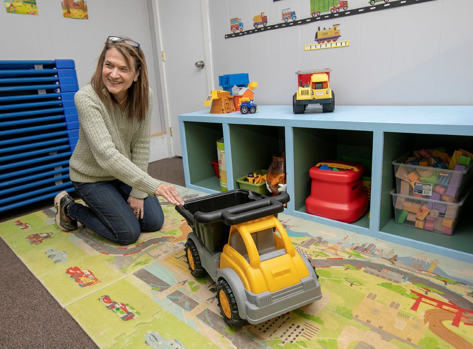 Debbie Finn, co-owner, gives a push to a toy dump truck, one of many toys and games at Grandma's Cozy Cottage, a new day care center at 210 Main St. in Wallingford, Tues., Dec. 11, 2018. The day care plans to open its doors on January 2nd. Dave Zajac, Record-Journal