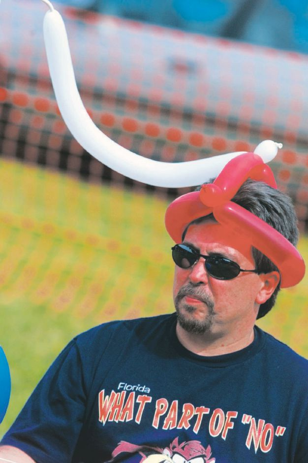Rick Coe of Wallingford is not wearing kielbasa on his head. He is donning a balloon hat that was crafted for his son Ricky Coe ,5, while the Coe family was at the Polka Fest