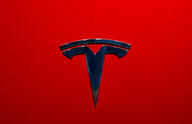 FILE- This Oct. 3, 2018, file photo shows the logo of Tesla model 3 at the Auto show in Paris. The National Transportation Safety Board says Tesla's Autopilot semi-autonomous driving system was in use when one of its cars drove beneath a semitrailer in Florida in March, killing the driver. (AP Photo/Christophe Ena, File)