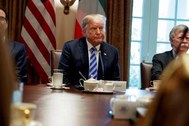 President Donald Trump listens during an expanded bilateral meeting with the Emir of Kuwait Sheikh Sabah Al Ahmad Al Sabah in the Cabinet Room of the White House, Wednesday, Sept. 5, 2018, in Washington. (AP Photo/Evan Vucci)