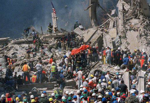 CRIME TERRORISM WORLD TRADE CENTER TWIN TOWERS TERRORIST ATTACK DEBRIS BUILDING DAMAGE RESCUE WORKERS CARRYING BODY BAG VICTIMS GROUND ZERO ORANGE BAG