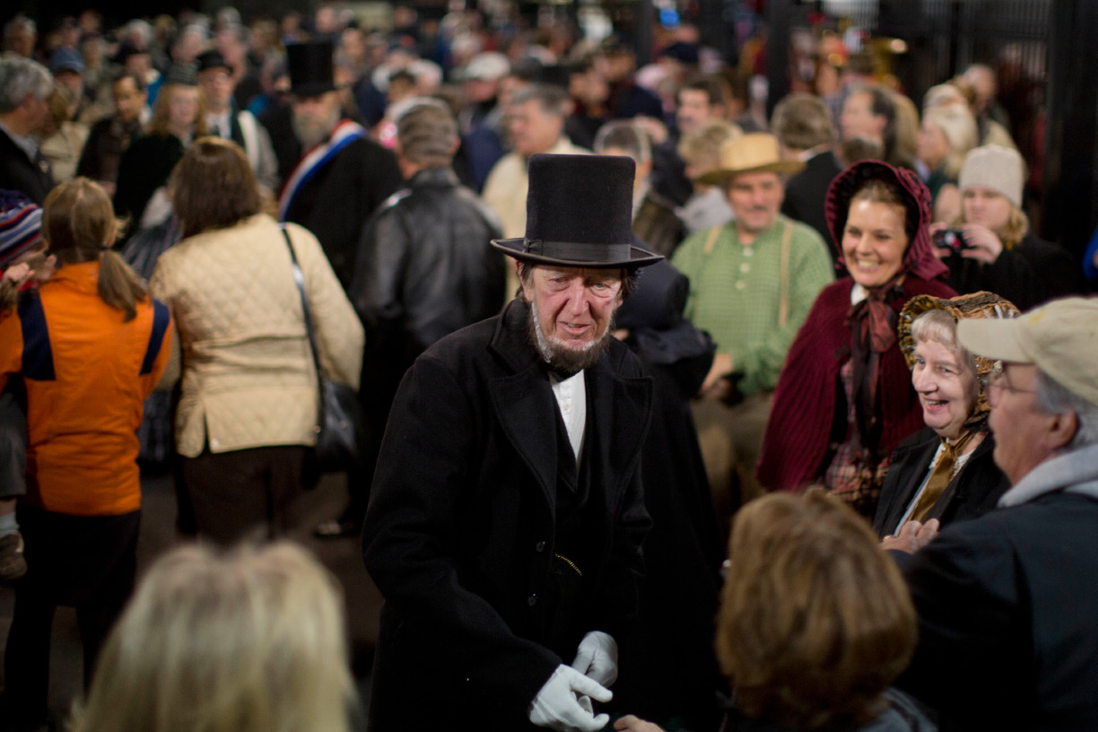 President Abraham Lincoln, portrayed by presenter Robert Costello is greeted Monday, Nov. 18, 2013, at the Gettysburg Train Station in Gettysburg, Pa. Tuesday, Nov. 19, marks the 150th anniversary of Lincoln