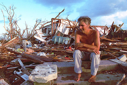 Janny Vancedarfield sits in front of the debris that was once his house September 1, 1992, in Florida City, Fla. Vancedarfield lived in this house with six other family members before it was destroyed by Hurricane Andrew in September 1992.  This summer marks the five year anniversary of the hurricane. (AP Photo/Lynn Sladky)