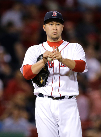 FILE - In a Wednesday, May 25, 2016 file photo, Boston Red Sox relief pitcher Junichi Tazawa prepares to throw during the ninth inning of a baseball game in Boston. Junichi Tazawa has agreed to a $12 million, two-year contract with Marlins, a person familiar with agreement says, Thursday, Dec. 15, 2016. (AP Photo/Charles Krupa, File)