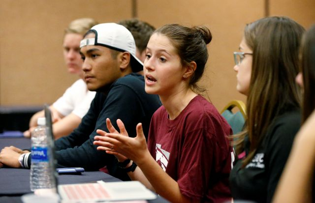 In this, Wednesday, March 14, 2018 photo, Casey Sherman, center, 17, lead student coordinator for the Parkland march, speaks during a planning meeting with Marjory Stoneman Douglas High School students, parents and volunteers in a hotel meeting room in Coral Springs, Fla. The students from Marjory Stoneman Douglas High School have spearheaded what could become one of the largest marches in history. Organizers say they are expecting perhaps 1 million people in the nation's capital...