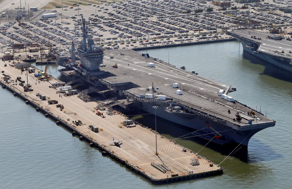 The nuclear powered aircraft carrier USS Dwight D. Eisenhower sits pier side at Naval Station Norfolk in Norfolk, Va., Wednesday, April 27, 2016. (AP Photo/Steve Helber)