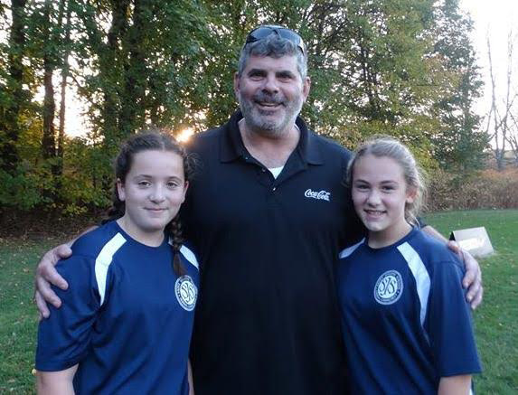 Trish and Emma thank Coach Dave for all his hard work, and Coach Kelly too.