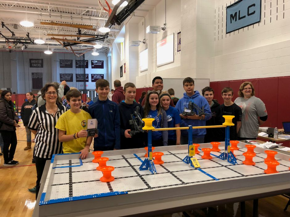 Middle School of Plainville robotics team members are pictured at their first competition with advisors and faculty members Camille Westfall and Laurel Schwartz.