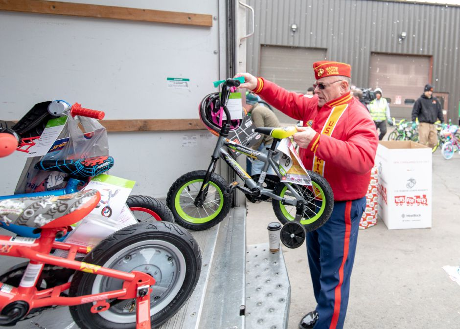 James Morris, commandant of the Hardware City Detachment of the Marine Corps League, loads bikes into a truck after Manafort Brothers Inc donated 100 bikes to the Marine Reserves Toys for Tots program on Dec. 12, 2018. | Devin Leith-Yessian/Plainville Citizen