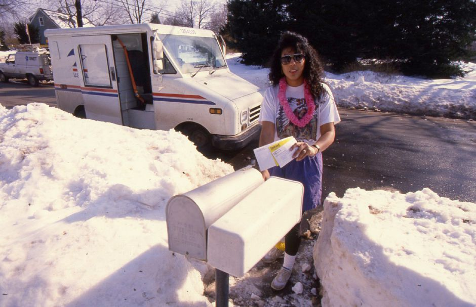 RJ file photo - Letter carrier Liz Penafiel delivers the main in Wallingford, set for summer fun. Postmaster Andrew Tengeres declared a summer holiday Feb. 18, 1994, and urged workers to dress for the occasion to fight the February blahs.