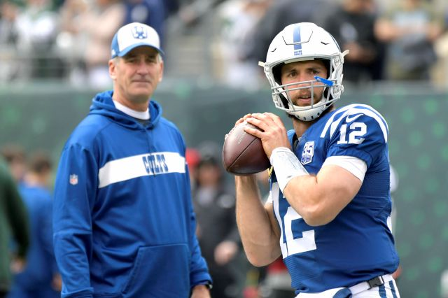 FILE - In this Oct. 14, 2018, file photo, Indianapolis Colts quarterback Andrew Luck (12) warms up as head coach Frank Reich looks on prior to an NFL football game against the New York Jets, in East Rutherford, N.J. The Colts play the Kansas City Chiefs in a divisional playoff game on Saturday, Jan. 12, 2019.(AP Photo/Bill Kostroun, File)