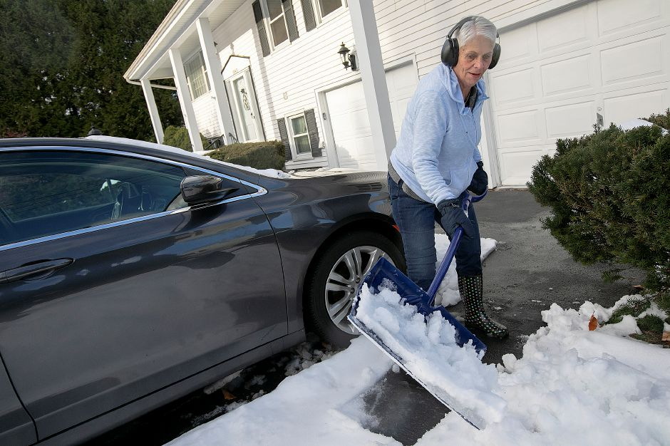 Judy Logan, of Southington, shovels heavy snow in the driveway of her Meriden Avenue residence, Fri. Nov. 16, 2018. Dave Zajac, Record-Journal