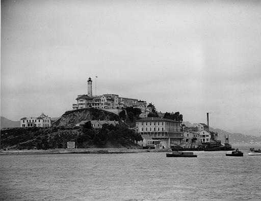 Three armored railroad cars arrive on a car ferry at the United States Penitentiary on Alcatraz Island, San Francisco, Calif., on August 22, 1934. Under the watchful eyes of guards carrying rifles, the prisoners, among them former Chicago gang leader Al Capone, leave the coaches for transfer to the cell house. (AP Photo)
