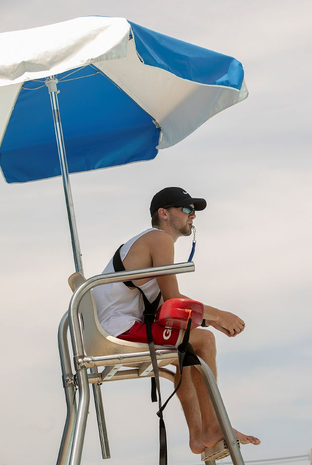 Lifeguard Joe Asmus, 19, of Wallingford, watches over the Wallingford Community Pool, Monday, August 6, 2018. Dave Zajac, Record-Journal