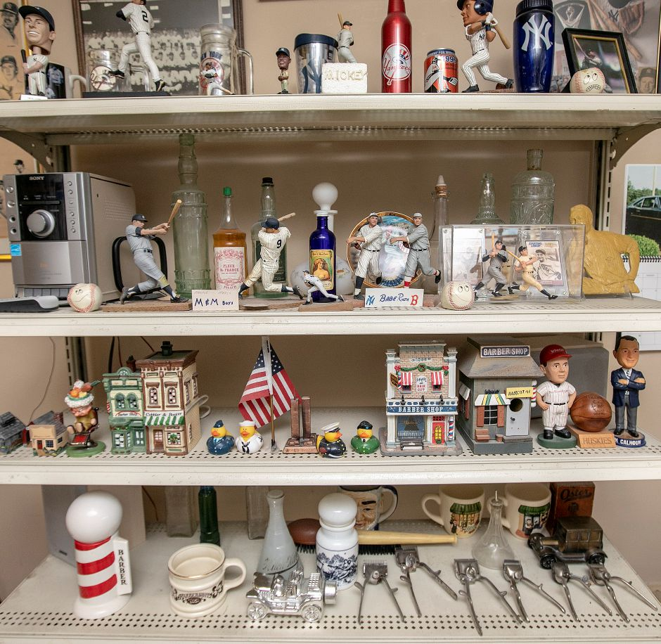 "New York Yankees and other memorabilia on the shelves of Prisco ""Pic"" DeLuca"