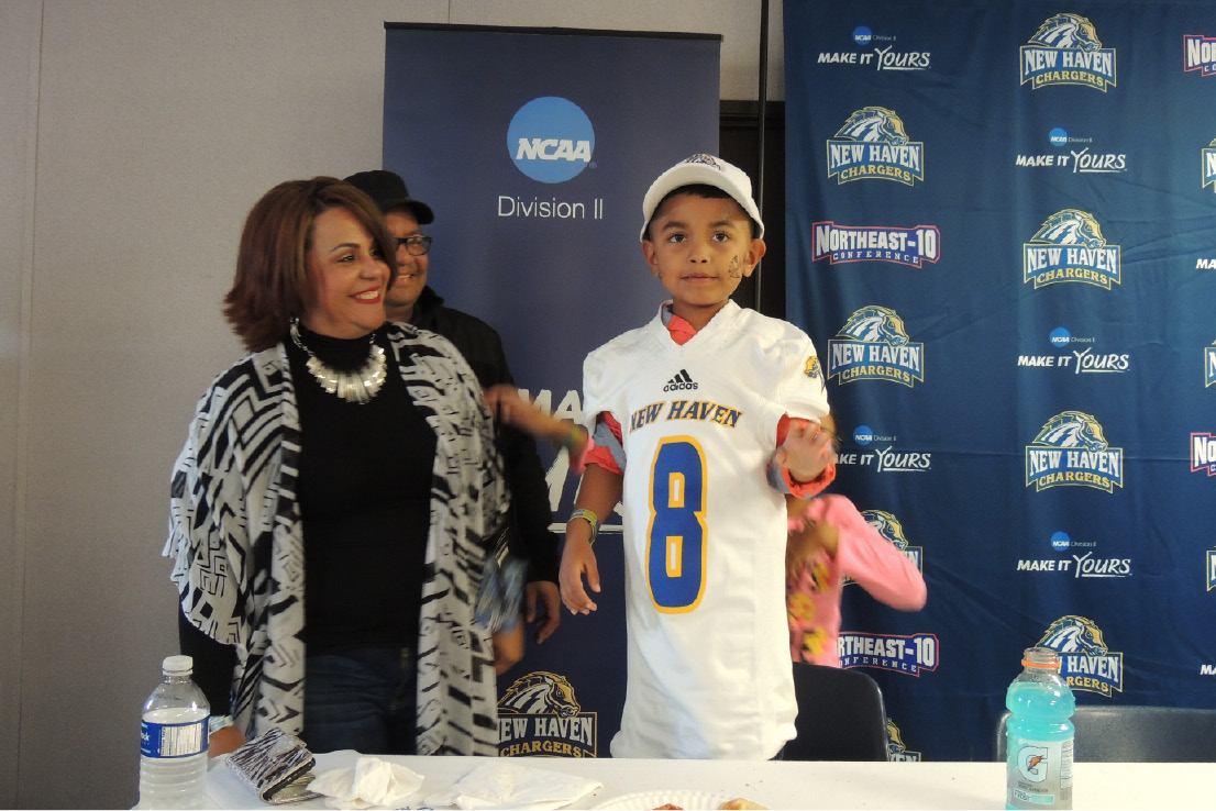 Jeshua Lopez poses in his new University of New Haven football jersey after signing with the time on Sunday, Oct. 16, 2016. | Photo Courtesy of the University of New Haven Athletic Department