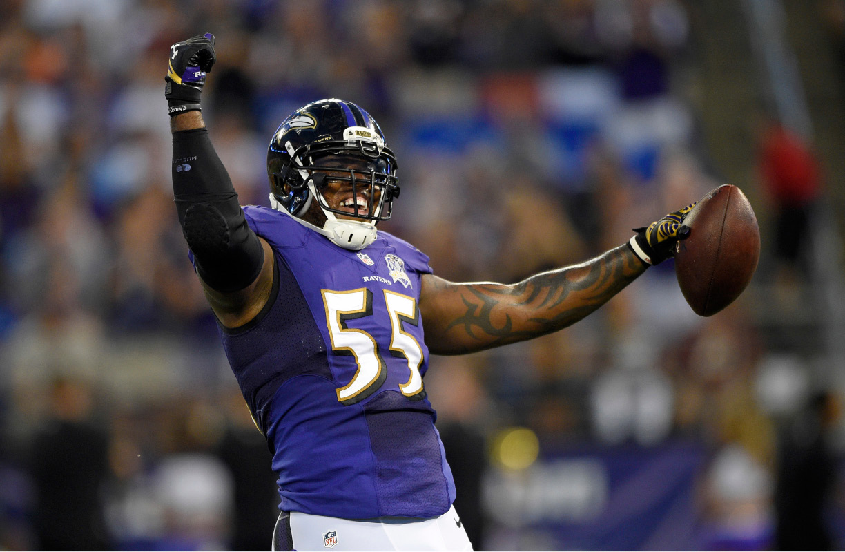 FILE - In this Aug. 29, 2015, file photo, Baltimore Ravens outside linebacker Terrell Suggs celebrates after intercepting a pass-attempt by Washington Redskins quarterback Kirk Cousins in the first half of a preseason NFL football game in Baltimore. Baltimore (7-5) has won four of its past five games, but entered the week tied with the Steelers for first place in the AFC North. The Ravens play the New England Patriots on Monday, Dec. 12, 2016. (AP Photo/Nick Wass, File)