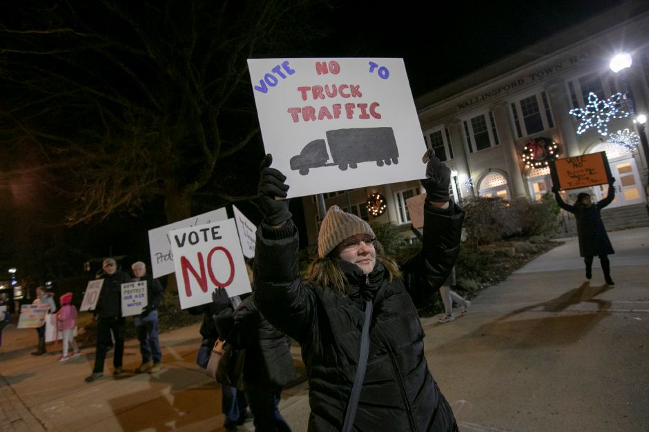 "Jen Frechette, of Wallingford, holds a sign ""No Truck Traffic"" while protesting development of the former Bristol-Myers Squibb property, Mon. Jan. 14, 2019. Dave Zajac, Record-Journal"
