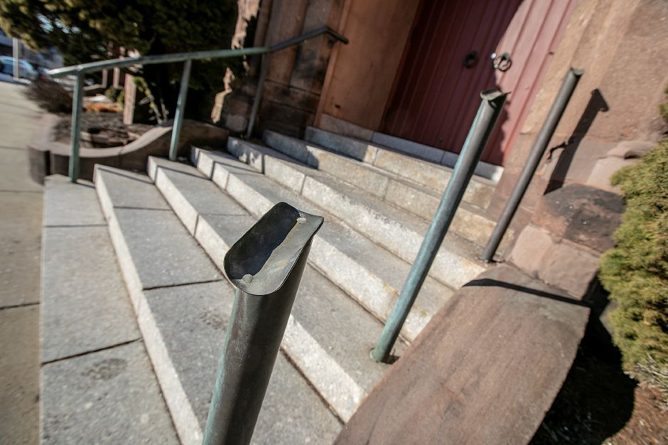 A missing railing from the front steps of St. Andrew