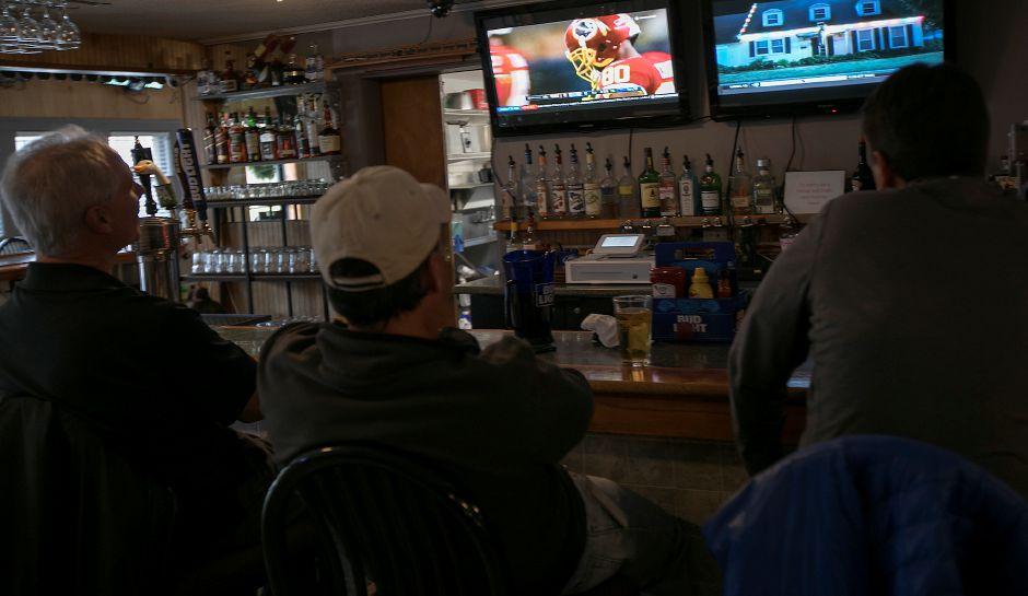 Patrons of the new Dawg House Bar & Grille on Broad Street in Meriden watch sports, Friday, Dec. 1, 2017. The business opened in mid-November. Dave Zajac, Record-Journal