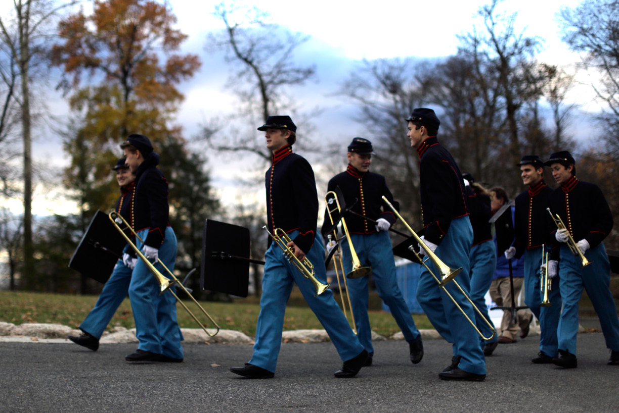 Band members arrive before a ceremony commemorating the 150th anniversary of the dedication of Soldiers National Cemetery and President Abraham Lincoln