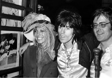 Keith Richards from the Rolling Stones arrives at the premiere of the new Beatles cartoon film Yellow Submarine with Anita Pallenberg at the London Pavillion Cinema, England on July 17, 1968. (AP Photo/Peter Kemp)