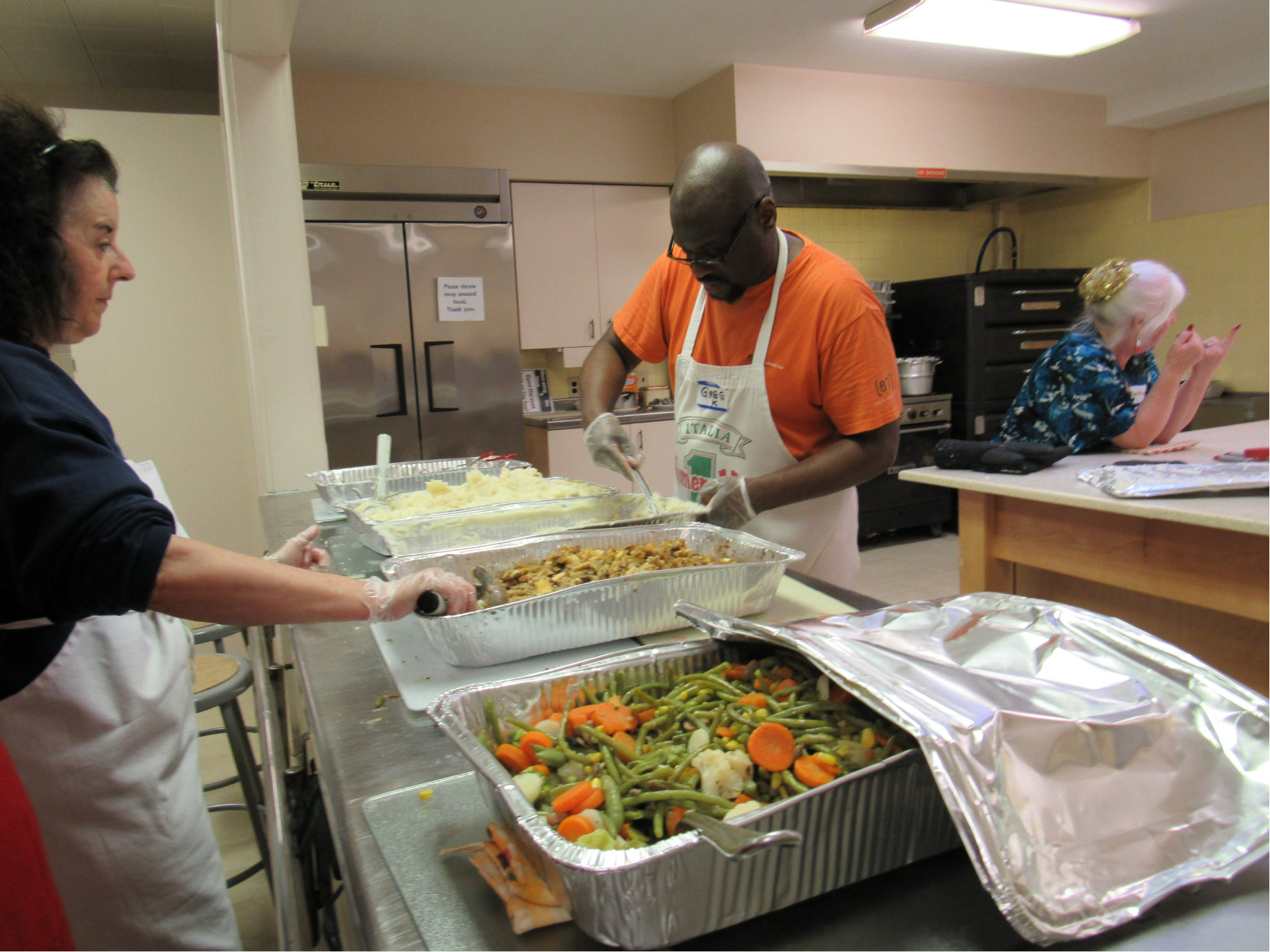 Volunteers put together meals at the First Congregational Church