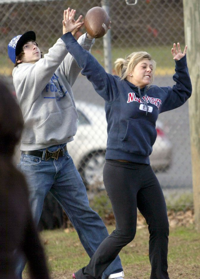 MERIDEN, Connecticut - Wednesday, November 4, 2009 - Wilcox Tech Powder Puff player Tara Galko blocks a pass from Wilcox football player Kyle Millington, who is coaching the puff team. Rob Beecher / Record-Journal
