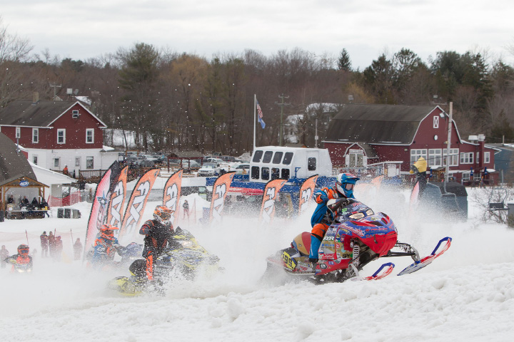 Wyatt Hoffman of New Berlin (199) heads up the hill from the start Sunday during the debut of East Coast Snocross race at Mount Southington in Plantsville Mar. 19, 2017 | Justin Weekes / For the Record-Journal