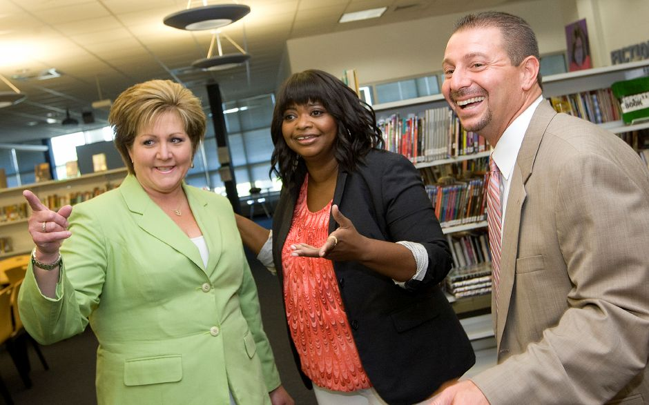 Academy award winning actress and author, Octavia Spencer, center, shares smiles with Pamela Bahre, board of education member, left, and Mark Benigni, schools superintendent, during an end-of-year celebration for students who read a million words throughout the year at Lincoln Middle School, Monday, June 16, 2014. Spencer is best known for her role as an outspoken maid in the 2011 film The Help. | Dave Zajac / Record-Journal