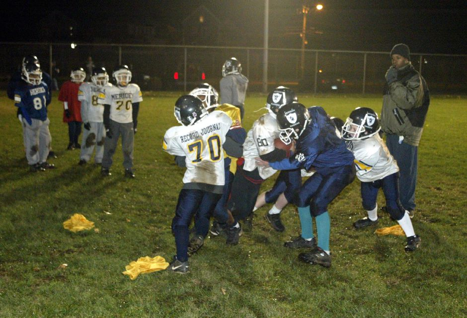 Meriden Raiders Peewee Football team practices at Columbus Park on Nov. 17, 2005. The Raiders are undefeated this year.