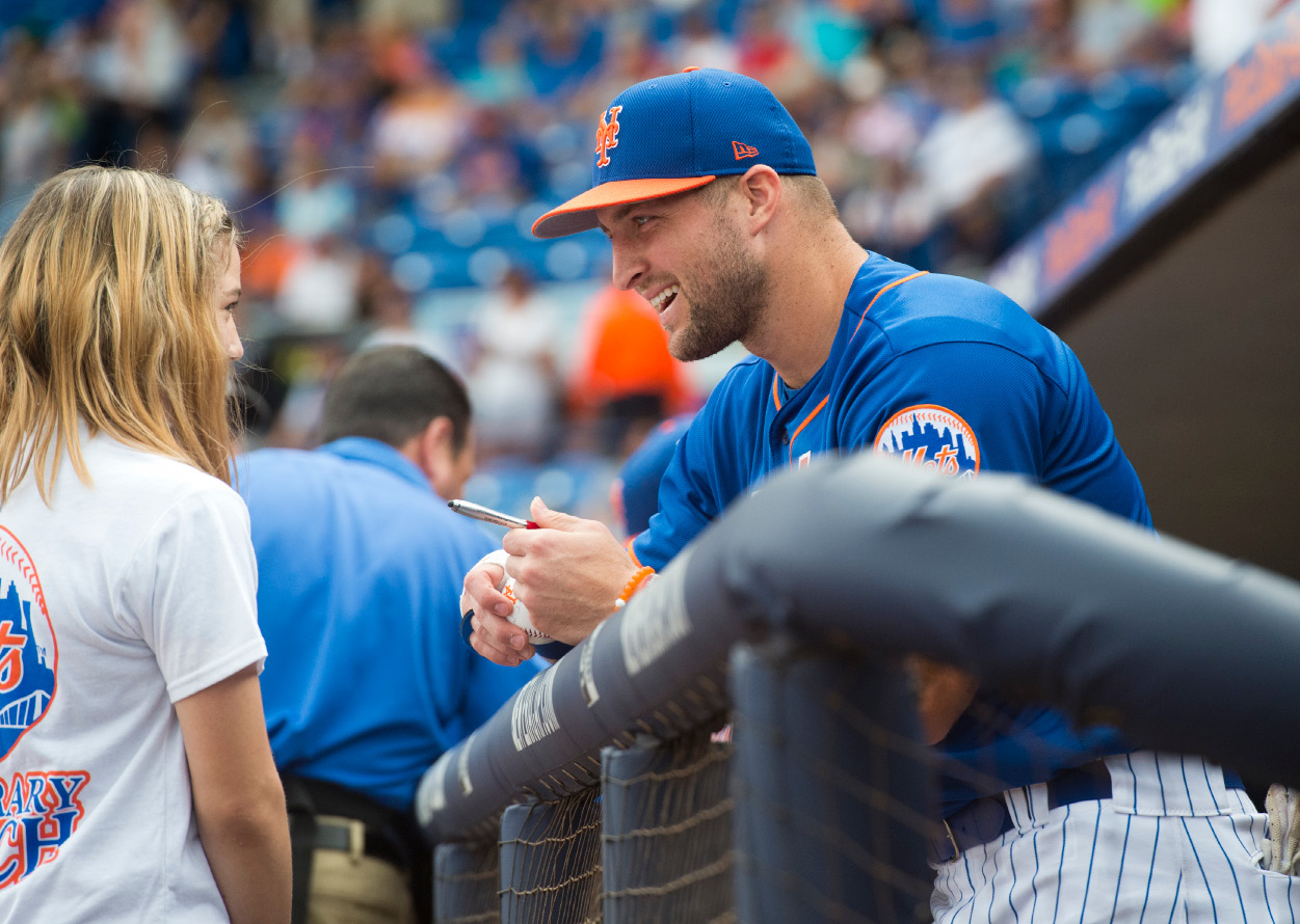 "Tim Tebow signs a ball for Mackenzie Demers, 12, of Port St. Lucie, before the New York Mets played the Boston Red Sox in a spring training baseball game on Wednesday, March 8, 2017, at First Data Field in Port St. Lucie, Fla. ""It was very cool to meet him,"" said Demers, who was the Make-A-Wish honorary coach for the game. Demers also got a birthday card signed for her school principal who is a Tim Tebow fan. (Molly Bartels/The Stuart News via AP)"