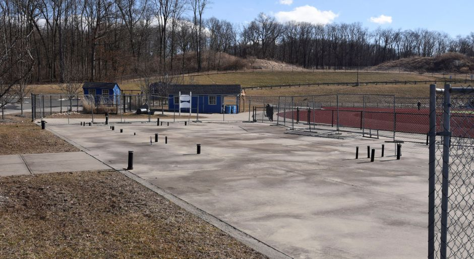 The concrete pad in front of the Coginchaug High School athletic complex, pictured on Feb. 26, where The Benchwarmers have proposed the latest plan for a field house. | Bailey Wright, Record-Journal