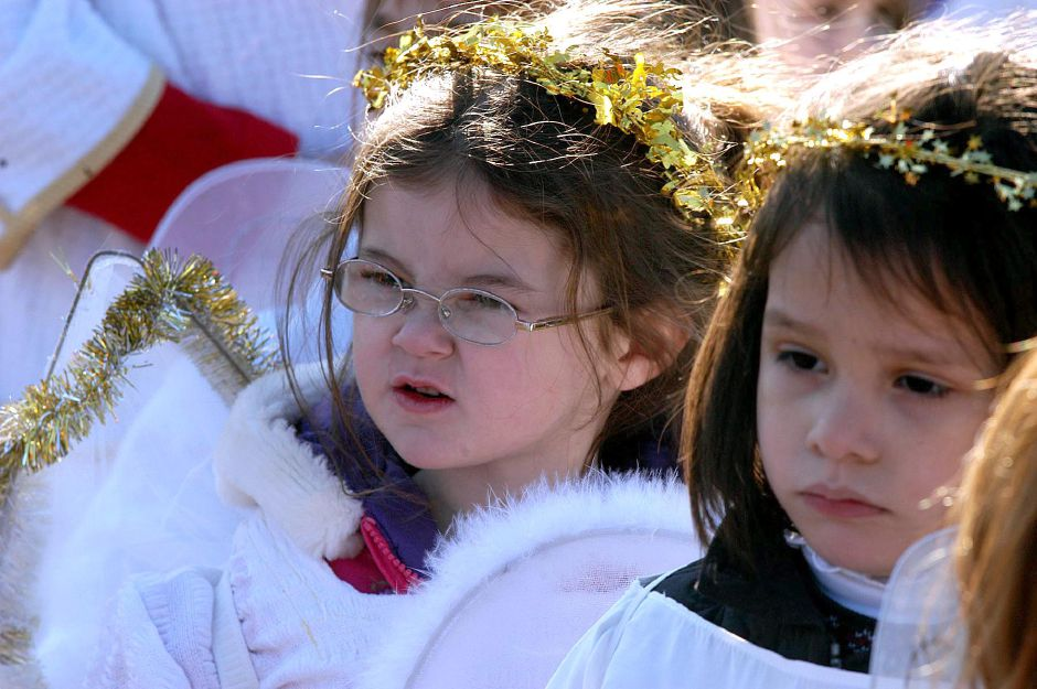 three-year-old Molly Yale (with glasses) is one of the little angels during the nativity scene at the Francisean Life Center