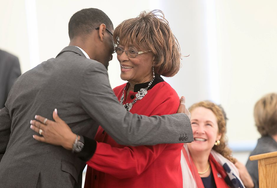 Rhudean Raye hugs keynote speaker Rev. Derrill Antonio Blue, during the Martin Luther King Jr./Albert Owens 2018 Scholarship Breakfast at Maloney High School, Monday, Jan. 15, 2018. Raye is president and founder of the annual event. Dave Zajac, Record-Journal