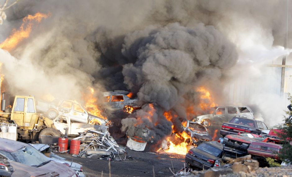 Cars and machinery burn at Underpass Recycling Corp., a used auto parts facility, on South Broad St. in Wallingford, Thursday evening, April 24, 2008. Many vehichles and some structures on the property were heavily damaged in the fire. (Christopher Zajac/Record-Journal)