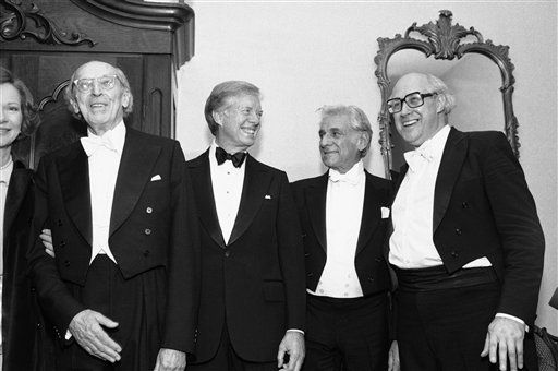 Conductor Aaron Copland is joined by President Jimmy Carter and other friends, National Symphony Music Director Mstislav Rostropovich, right, and conductor Leonard Bernstein after a salute to Copland at the Kennedy Center in Washington on Nov. 14, 1980, to celebrate his 80th birthday. From left: Copland; Carter; Bernstein; and Rostropovich. (AP Photo/Jeff Taylor)