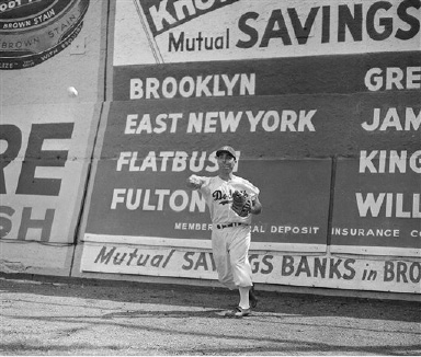Outfielder Carl Furillo demonstrates why he is the master of the right field wall during a Brooklyn Dodgers workout, Aug. 22, 1955, in  New York.  (AP Photo/Harry Harris)