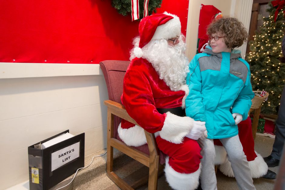 Chloe Freeman 8 sits with Santa Saturday during Season of Celebration at the Town Hall in Wallingford December 2, 2017 | Justin Weekes / For the Record-Journal